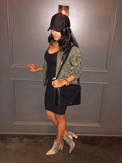 "Linda Cisneros is wearing Alexander Wang ""Alexander Wang Prisma Small Leather Shoulder Bag, Black"""