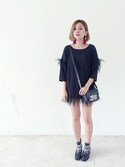 "stylist/evonchng is wearing no brand ""Prowlwow feather tunic"""